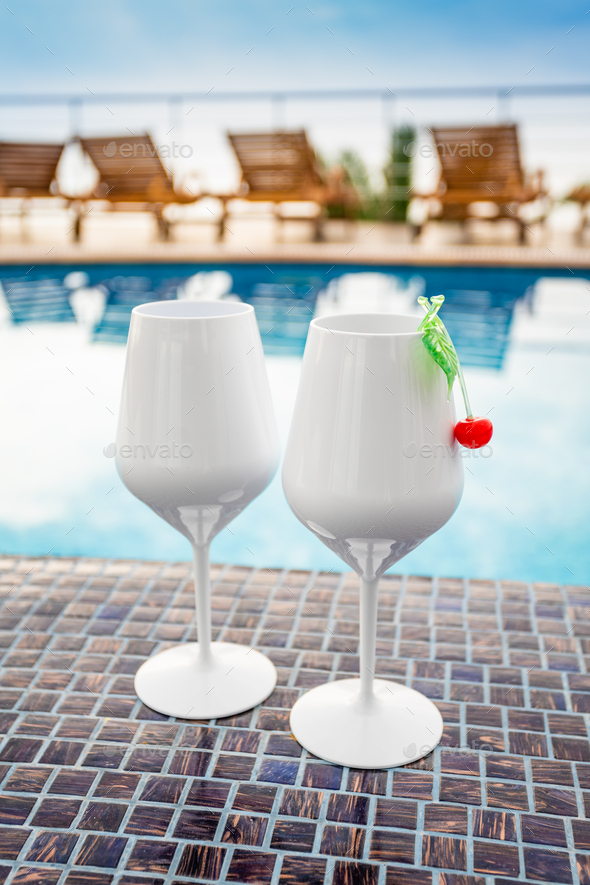 cocktail on the pool  at the tropical resort - Stock Photo - Images