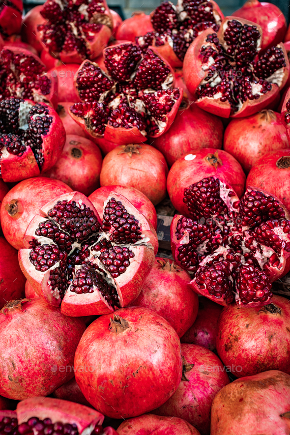 Red pomegranate fruit at street market. Group of pomegranates - Stock Photo - Images