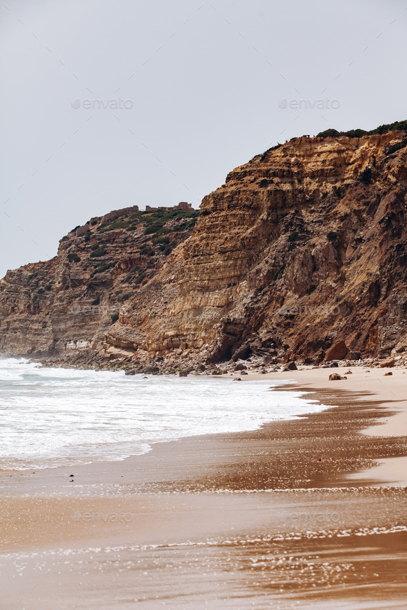 Beautiful view of the sea waves from the rocks in algarve, Portugal - Stock Photo - Images