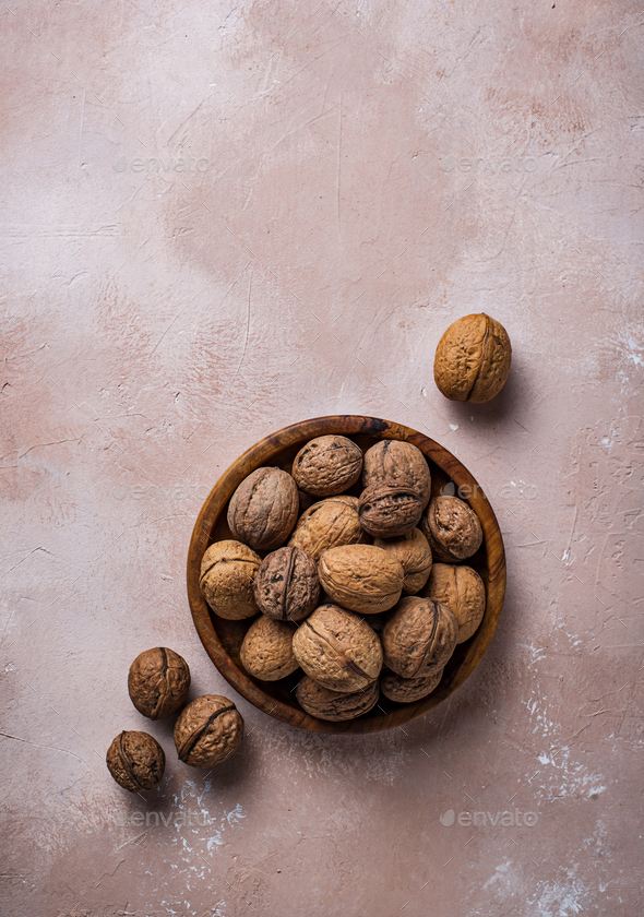 Walnuts in wooden box on lignt brown background - Stock Photo - Images