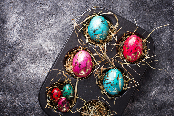 Easter painted chicken and quail eggs - Stock Photo - Images