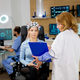 Patient woman scanning her brain and looking at a clipboard - PhotoDune Item for Sale