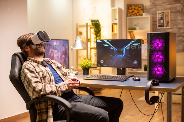 Professional gamer man using VR headset to play on powerful PC - Stock Photo - Images