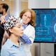 Doctor arranging neurology scanning headset for tests on a female patient - PhotoDune Item for Sale