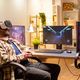 Professional gamer man using VR headset to play on powerful PC - PhotoDune Item for Sale
