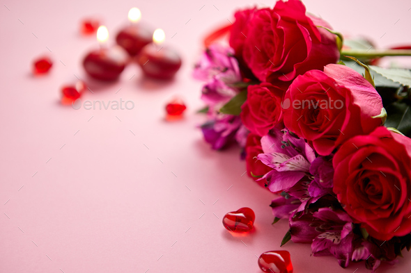 Mixed flowers bouquet with roses, candles and heart shaped acrylic decorations - Stock Photo - Images