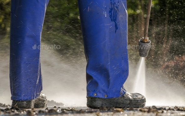 Pressure Washing Pavement - Stock Photo - Images