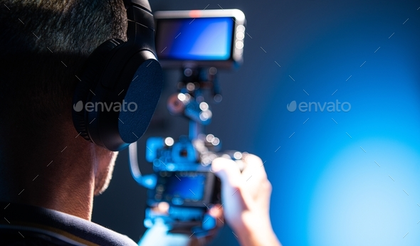 Cameraman DSLR Operator - Stock Photo - Images
