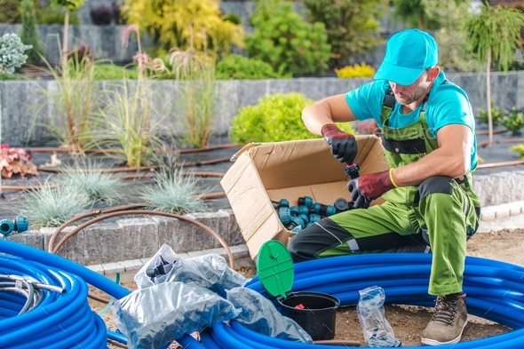 Building Garden Watering System - Stock Photo - Images