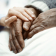 Hand of woman touching senior man in clinic - PhotoDune Item for Sale