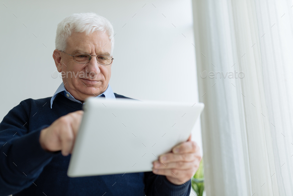 Aged man with digital tablet - Stock Photo - Images