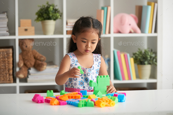Playing with plastic blocks - Stock Photo - Images