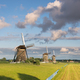 Windmills under great clouds in rural Holland - PhotoDune Item for Sale
