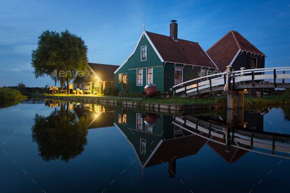 Cheese farm with reflection at twilight - Stock Photo - Images