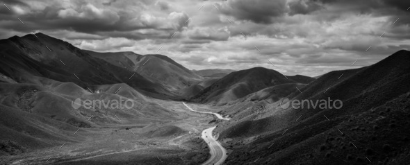 black and white road in the mountains - Stock Photo - Images