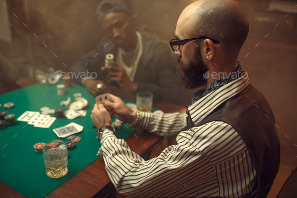 Poker players place money bets on gaming table - Stock Photo - Images
