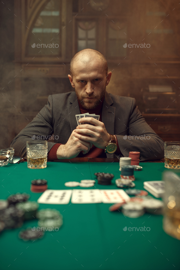 Poker player in suit plays in casino - Stock Photo - Images
