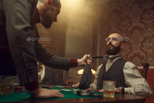 Poker player grabbed his opponent's tie, casino - Stock Photo - Images