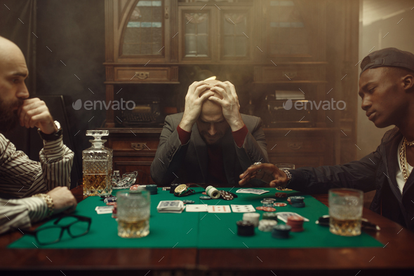 Poker player spend all money in casino, risk - Stock Photo - Images