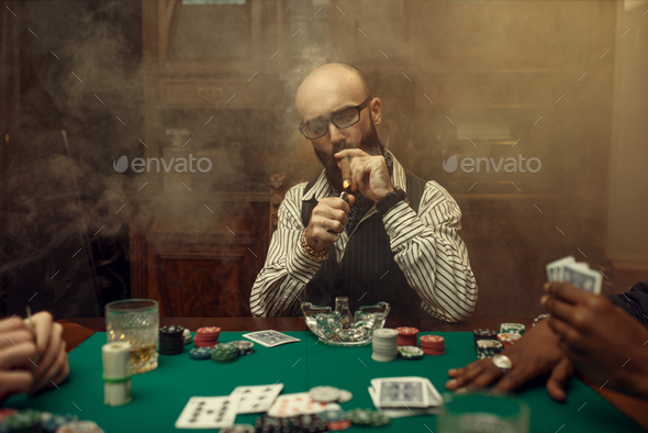 Bearded poker player with cigar, casino - Stock Photo - Images