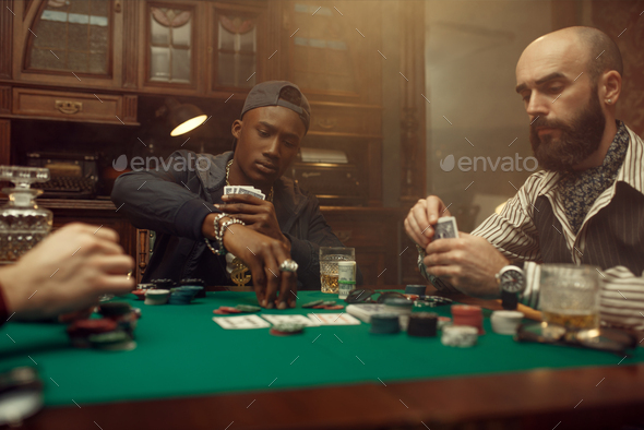 Two poker players place bets in casino - Stock Photo - Images