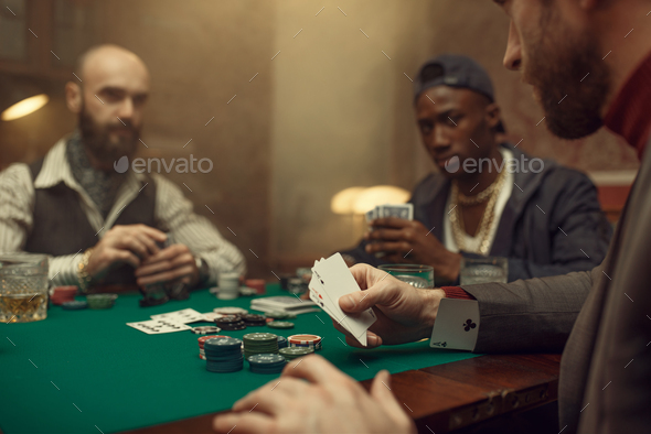Male player cheating in poker - Stock Photo - Images