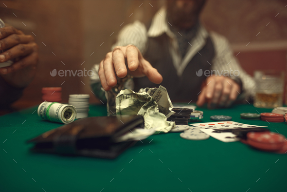 Poker player takes the bet, casino - Stock Photo - Images