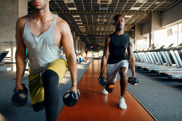 Two male persons doing exercise with dumbbells - Stock Photo - Images