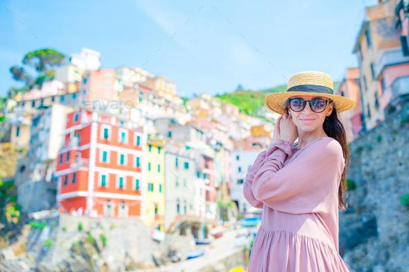 Young woman with great view at old village Riomaggiore, Cinque Terre, Liguria, Italy. European - Stock Photo - Images