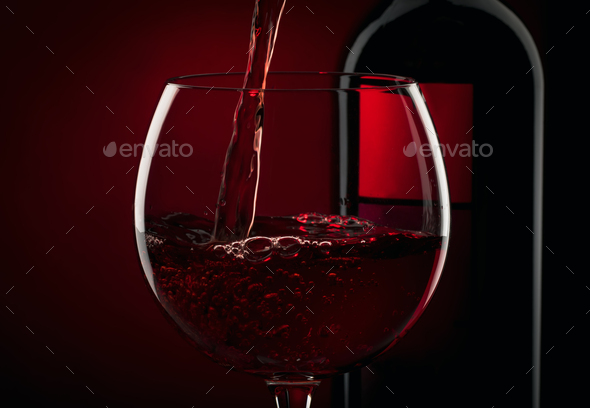 Pouring red wine - Stock Photo - Images