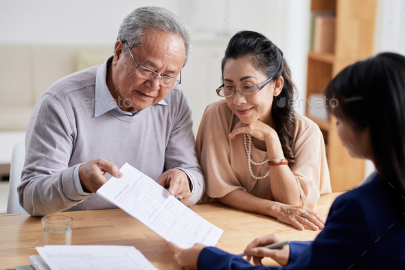 Studying Real Estate Purchase Agreement - Stock Photo - Images