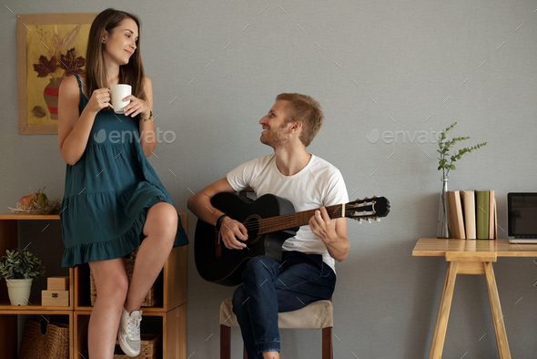 Playing song for her - Stock Photo - Images