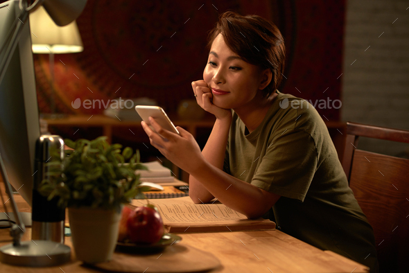 Reading message from boyfriend - Stock Photo - Images