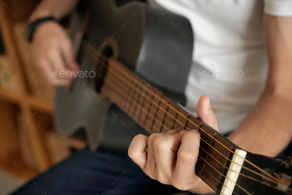 Hands playing guitar - Stock Photo - Images
