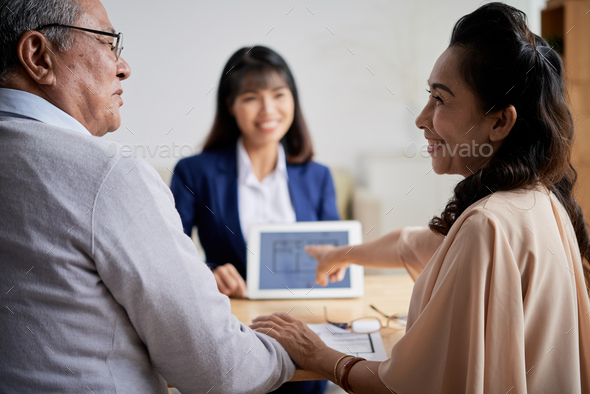 Making Choice at Office of Estate Agent - Stock Photo - Images