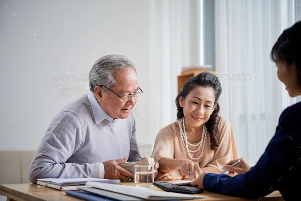Senior Couple Buying Real Estate - Stock Photo - Images