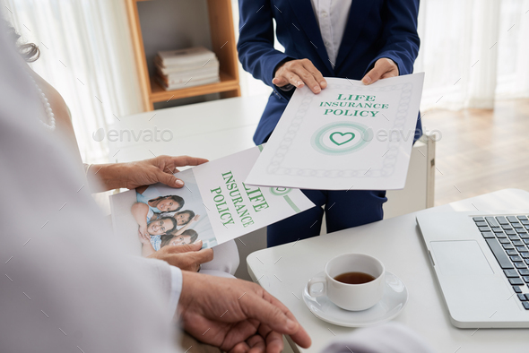 Discussing Life Insurance Program with Agent - Stock Photo - Images