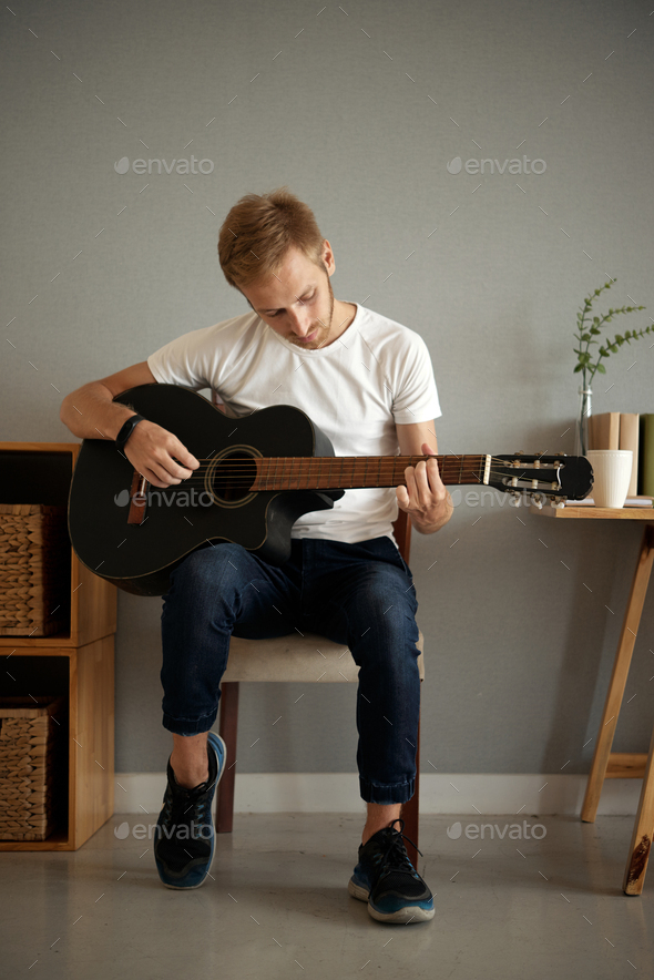 Learning to play guitar - Stock Photo - Images