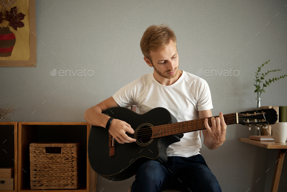Playing guitar at home - Stock Photo - Images