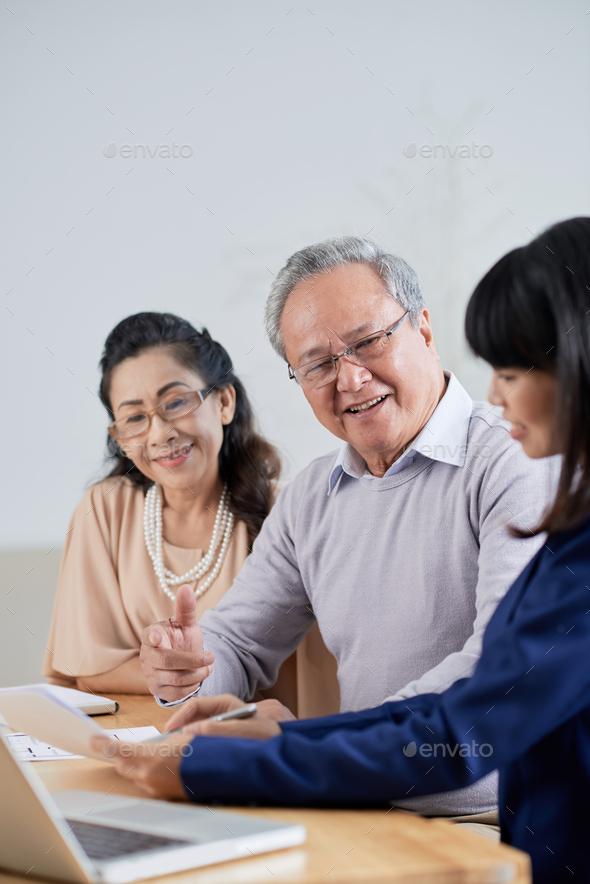 Signing Purchase Agreement - Stock Photo - Images