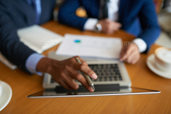 Reading data on laptop screen - Stock Photo - Images