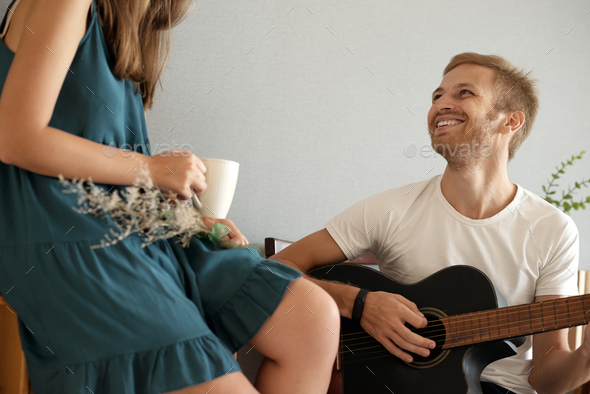 Enjoying playing for her - Stock Photo - Images