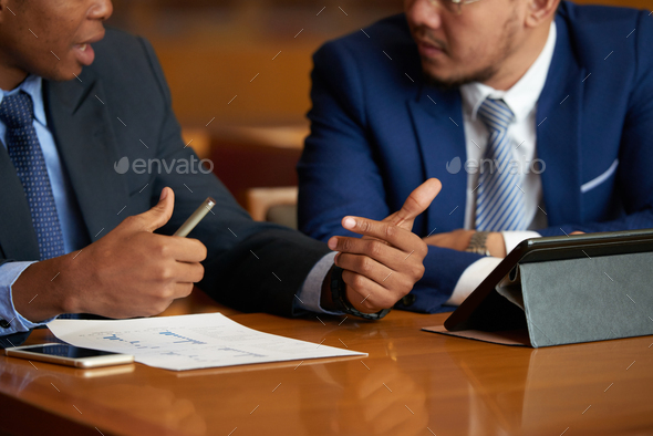Discussing busines report - Stock Photo - Images