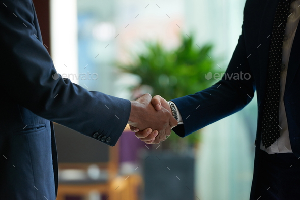 Firm handshake - Stock Photo - Images