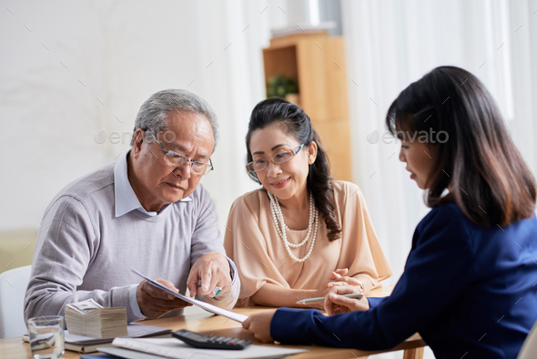 Discussing Terms of Purchase Agreement - Stock Photo - Images