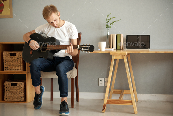 Home guitar practice - Stock Photo - Images