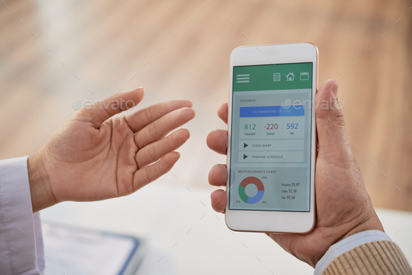 Teaching Patient to Use Health Monitoring App - Stock Photo - Images