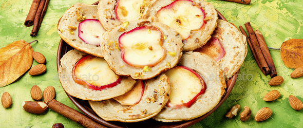 Fried pancakes with apples - Stock Photo - Images