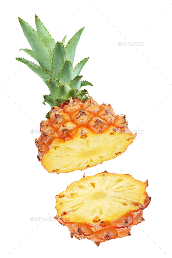 One halved pineapple and two slices isolated on white - Stock Photo - Images