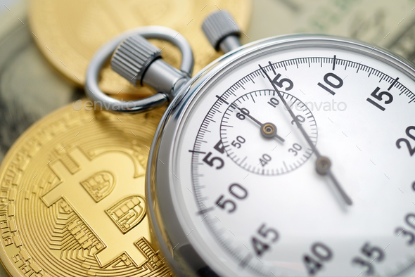 Physical golden bitcoin coins and mechanical analog stopwatch. - Stock Photo - Images